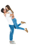 Boyfriend carrying his girlfriend Royalty Free Stock Photos