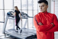 Boyfriend coach in the gym on the background of people on treadmills stock photo