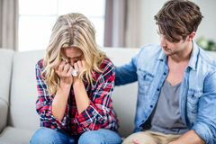 Boyfriend comforting sad girlfriend Royalty Free Stock Images
