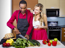 Boyfriend Cooking for Spouse. Sweet helpful boyfriend cooking for girlfriend at home Stock Images