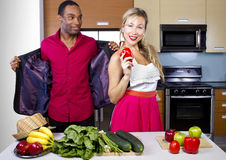 Boyfriend Cooking for Spouse. Sweet helpful boyfriend cooking for girlfriend at home Royalty Free Stock Image