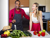 Boyfriend Cooking for Spouse Stock Photography