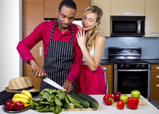 Boyfriend Cooking for Spouse Royalty Free Stock Photos