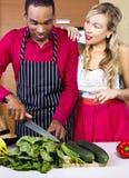 Boyfriend Cooking for Spouse. Sweet helpful boyfriend cooking for girlfriend at home Stock Photos