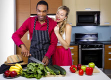 Boyfriend Cooking for Spouse Stock Images