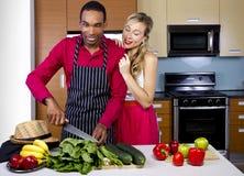 Boyfriend Cooking for Spouse. Sweet helpful boyfriend cooking for girlfriend at home Stock Images