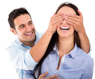 Boyfriend covering the eyes of his girlfriend Stock Photography