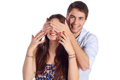 Boyfriend covering eyes of his girlfriend. Royalty Free Stock Images