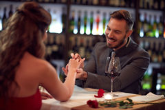 Boyfriend engage girlfriend in beautiful restaurant Royalty Free Stock Photos