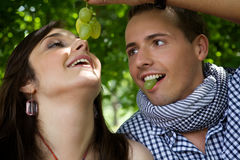 Boyfriend feeding girlfriend Royalty Free Stock Photo