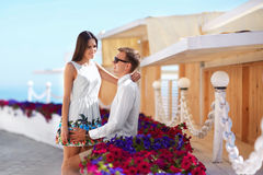 Boyfriend and girlfriend on a date. Easy going and beautiful young lovers. A romantic couple on a colorful resort royalty free stock photos