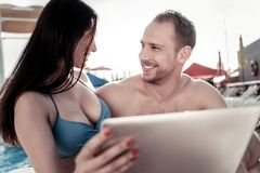 Boyfriend and girlfriend discussing something on digital tablet royalty free stock photos