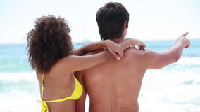 Boyfriend and girlfriend embracing each other. While at the beach stock video