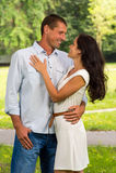 Boyfriend and girlfriend embracing outdoors. Smiling boyfriend and girlfriend embracing outdoors stock photos