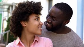 Boyfriend and girlfriend enjoying date, girl feeling safe in boyfriend arms. Stock photo stock images