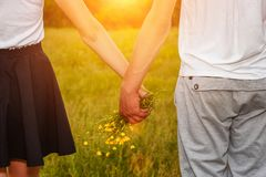 Boyfriend and girlfriend holding hands, romantic relationship royalty free stock photo