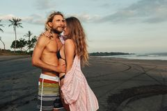 Boyfriend and girlfriend hugging on beach. In bali indonesia stock images