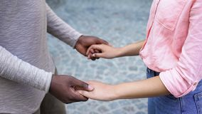 Boyfriend and girlfriend joining hands, feelings expression, affection and trust. Stock photo stock photography