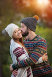 Boyfriend and girlfriend, kiss in winter stock photography