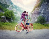 Boyfriend and girlfriend kissing on retro bike Royalty Free Stock Images