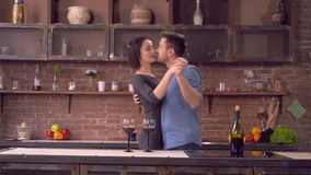Boyfriend and girlfriend laughing and dance in apartment. Couple in love dancing in kitchen. Happy family have fun smiling and enjoy evening in flat. Adult nice stock video