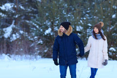 Boyfriend and girlfriend in love during holidays. copy space. Boyfriend and girlfriend in love together during winter holidays in snow forest. copy space stock photo