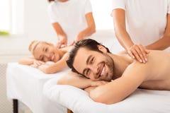 Boyfriend And Girlfriend Lying Enjoying Relaxing Massage At Spa Resort