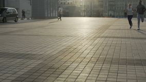 Boyfriend and girlfriend run across empty city square during weekend, exercise. Stock footage stock footage