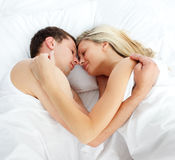 Boyfriend and girlfriend sleeping in bed Royalty Free Stock Photo