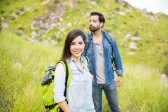 Woman hiking with her boyfriend Stock Photography
