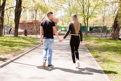 Boyfriend and girlfriend taking a walk in the park. In love and relationship. Happines and love Stock Images