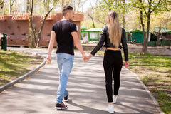 Boyfriend and girlfriend taking a walk in the park. In love and relationship. Happines and love Stock Photos