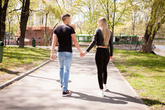 Boyfriend and girlfriend taking a walk in the park. In love and relationship. Happines and love Royalty Free Stock Photos