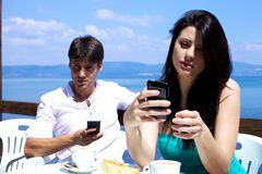 Boyfriend and girlfriend texting during breakfast Royalty Free Stock Image