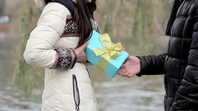 Boyfriend gives a girl a gift on Valentine's Day stock video