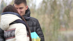 Boyfriend gives a girl a gift on Valentine's Day stock footage