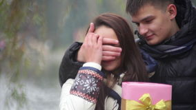 Boyfriend gives a girl a gift on Valentine's Day stock video footage