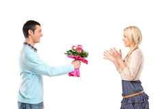 Boyfriend giving flowers to his girlfriend Stock Photo