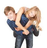 Boyfriend giving girl a piggyback Stock Images
