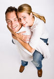 Boyfriend giving girlfriend piggy back ride Stock Photos
