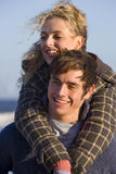 Boyfriend giving girlfriend piggy back ride Royalty Free Stock Images