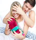 Boyfriend giving a surprise to her girlfriend Royalty Free Stock Photos