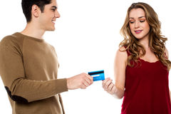 Boyfriend handing over credit card Stock Photo