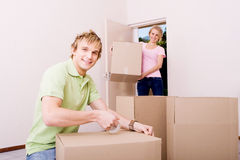 Boyfriend helping girlfriend move in Royalty Free Stock Photo