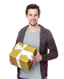 Boyfriend hold a gift box for his girlfriend Stock Photos