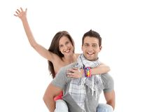 Boyfriend holding laughing girl waving Royalty Free Stock Photo