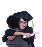 Boyfriend hug girlfriend on graduation - isolated Royalty Free Stock Image