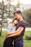 Boyfriend hugging his girlfriend Royalty Free Stock Images