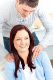 Boyfriend massaging his girlfriend's shoulders Stock Photos
