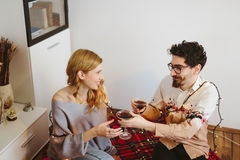 Boyfriend offering a glass to his girlfriend Royalty Free Stock Image